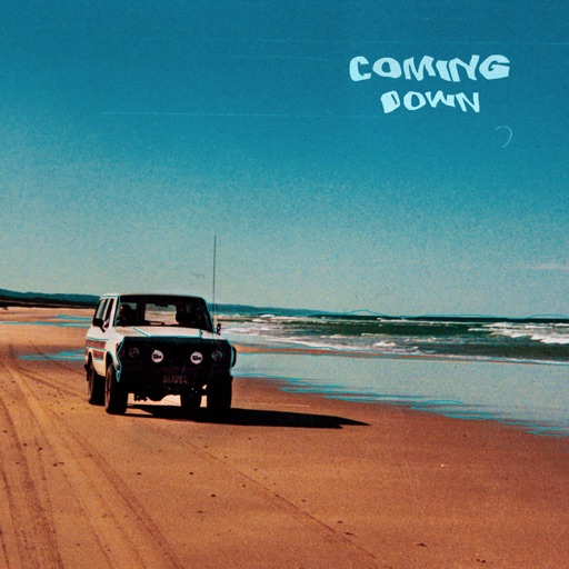 "Single cover for ""Coming Down"", with a Land Rover Discovery driving down a sandy beach."